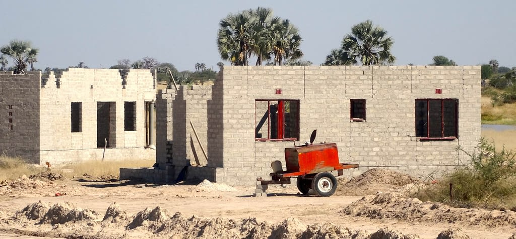 A partially constructed house made from grey bricks.